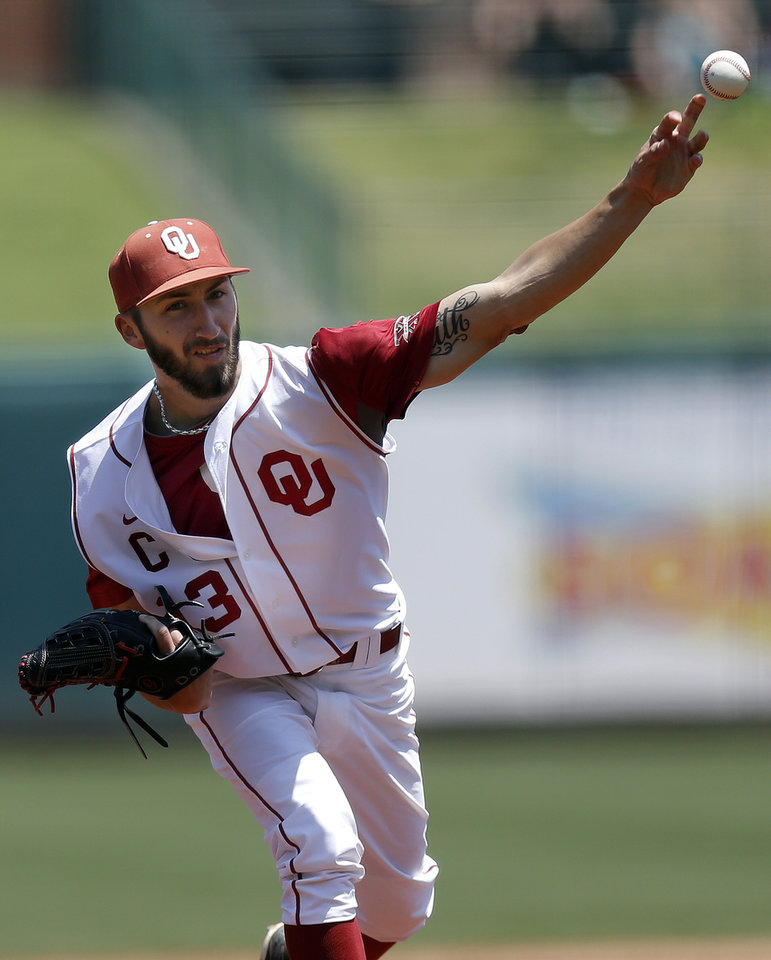 Photo - Oklahoma's Dillon Overton throws a pitch during the Bedlam baseball game between the University of Oklahoma and Oklahoma State University at the Chickasaw Bricktown Ballpark in Oklahoma CIty, Sunday, May 12, 2013. Photo by Sarah Phipps, The Oklahoman