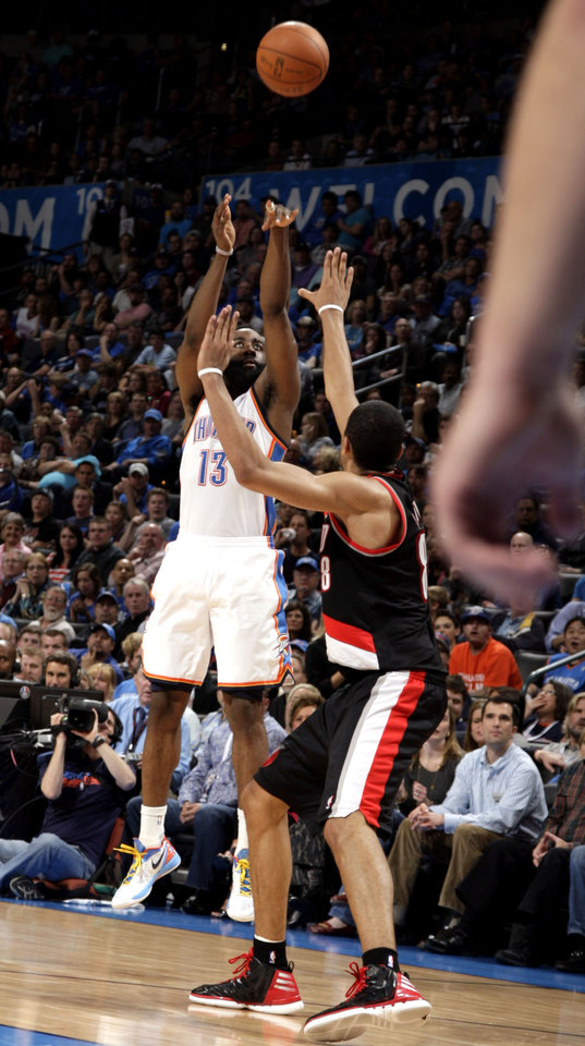 Oklahoma City's James Harden (13) shoots a three-pointer over Portland 's Luke Babbitt (8) during the NBA basketball game between the Oklahoma City Thunder and the Portland Trail Blazers at Chesapeake Energy Arena in Oklahoma City, Sunday, March 18, 2012. Photo by Sarah Phipps, The Oklahoman.
