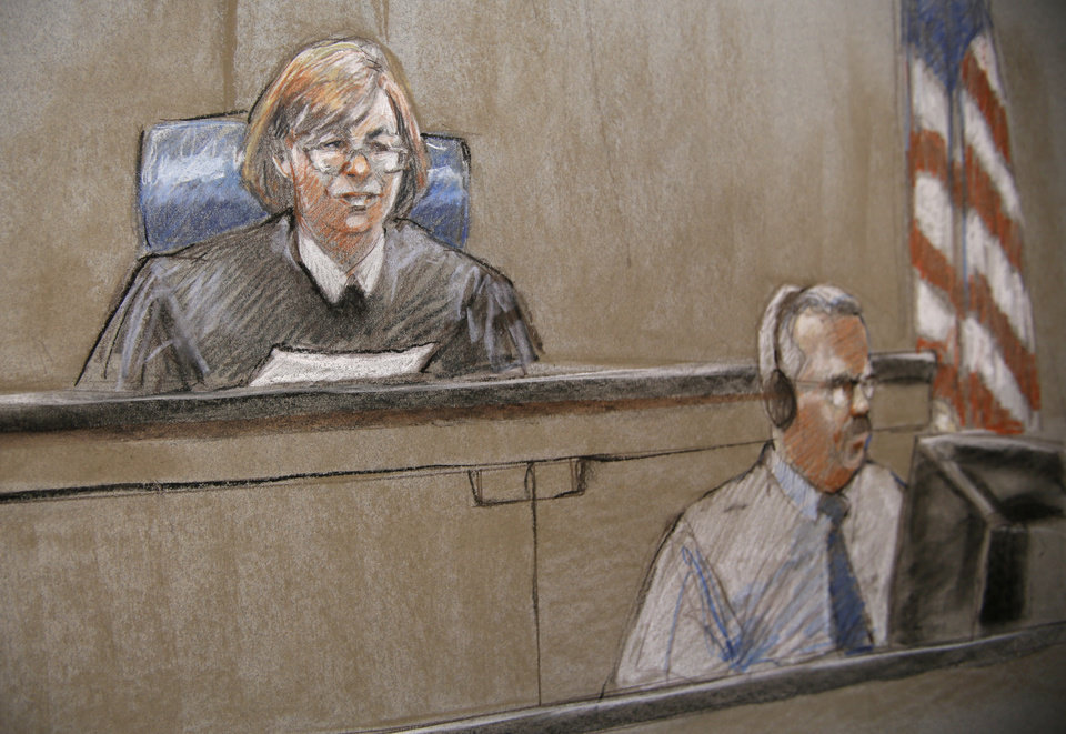 Photo - In this court room sketch, the Judge, U.S. Army Col. Tara Osborn and the court reporter are shown as Judge Osborn reads the jury instructions during court proceedings in the court martial of U.S. Army Maj. Nidal Malik Hasan, Thursday, Aug. 22, 2013, in Fort Hood, Texas. (AP Photo/Brigitte Woosley)