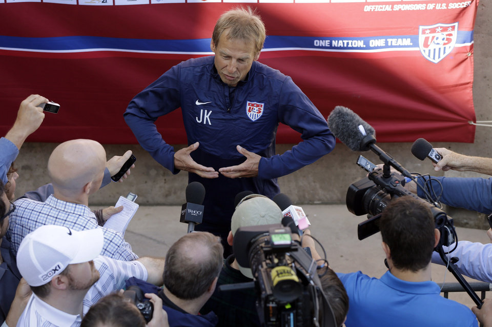 Photo - U.S. men's soccer coach Jurgen Klinsmann answers questions during training camp in preparation for the World Cup, Wednesday, May 21, 2014, in Stanford, Calif. (AP Photo/Marcio Jose Sanchez)