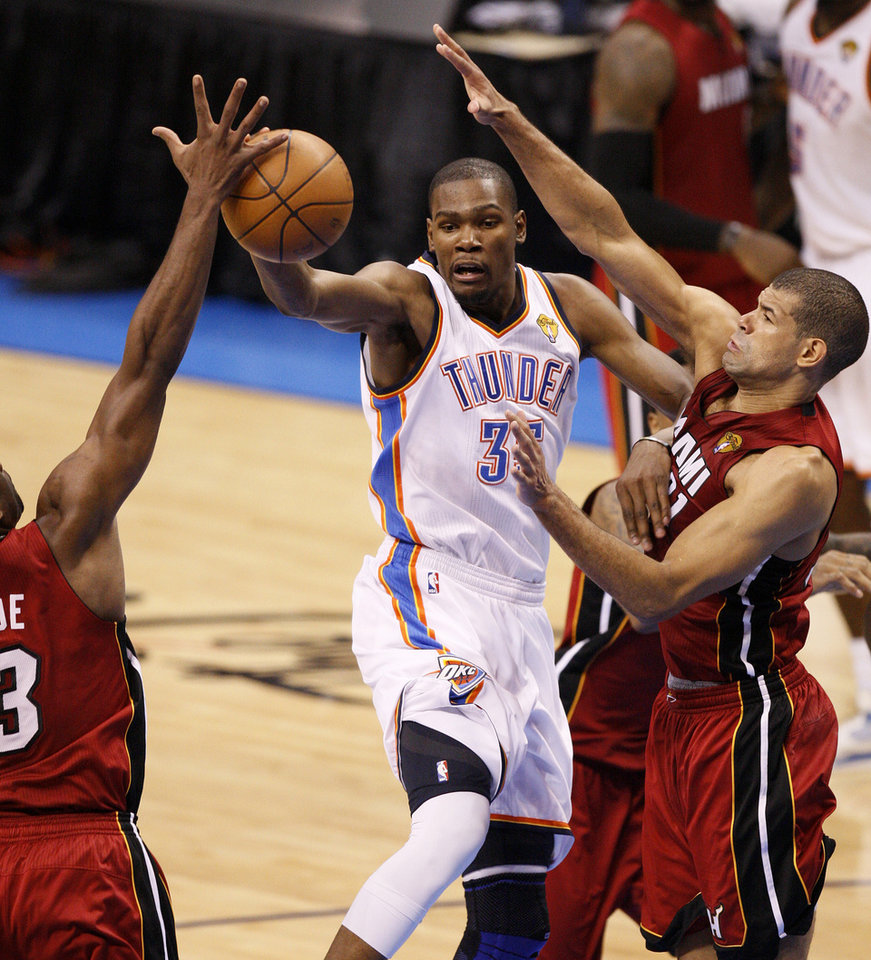 Oklahoma City's Kevin Durant (35) passes the ball between Miami's LeBron James, left, and Miami's Shane Battier during Game 1 of the NBA Finals between the Oklahoma City Thunder and the Miami Heat at Chesapeake Energy Arena in Oklahoma City, Tuesday, June 12, 2012. Photo by Nate Billings, The Oklahoman