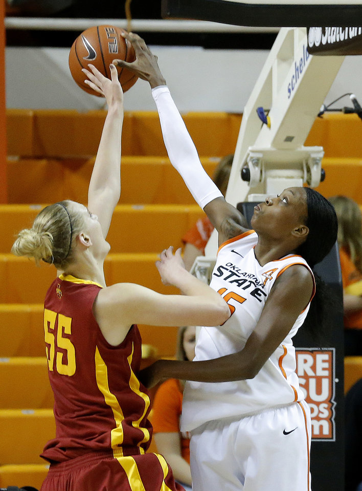 Photo - Oklahoma State's Toni Young (15) blocks the shot of Iowa State's Anna Prins (55) during the women's college basketball game between Oklahoma State and Iowa State at  Gallagher-Iba Arena in Stillwater, Okla.,  Sunday,Jan. 20, 2013.  OSU won 71-42. Photo by Sarah Phipps, The Oklahoman