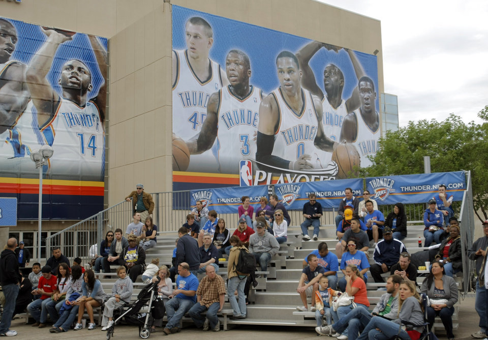 Photo - Fans watch a large video screen before the first round NBA basketball playoff game between the Oklahoma City Thunder and the Denver Nuggets on Wednesday, April 20, 2011, at the Oklahoma City Arena. Photo by Sarah Phipps, The Oklahoman