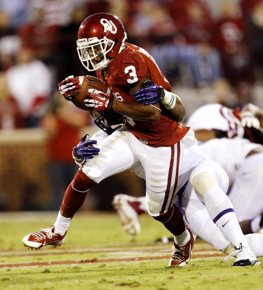 Oklahoma's Sterling Shepard (3) is brought down by TCU's Sam Carter (17) during a college football game between the University of Oklahoma Sooners (OU) and the TCU Horned Frogs at Gaylord Family-Oklahoma Memorial Stadium in Norman, Okla., on Saturday, Oct. 5, 2013. Photo by Steve Sisney, The Oklahoman