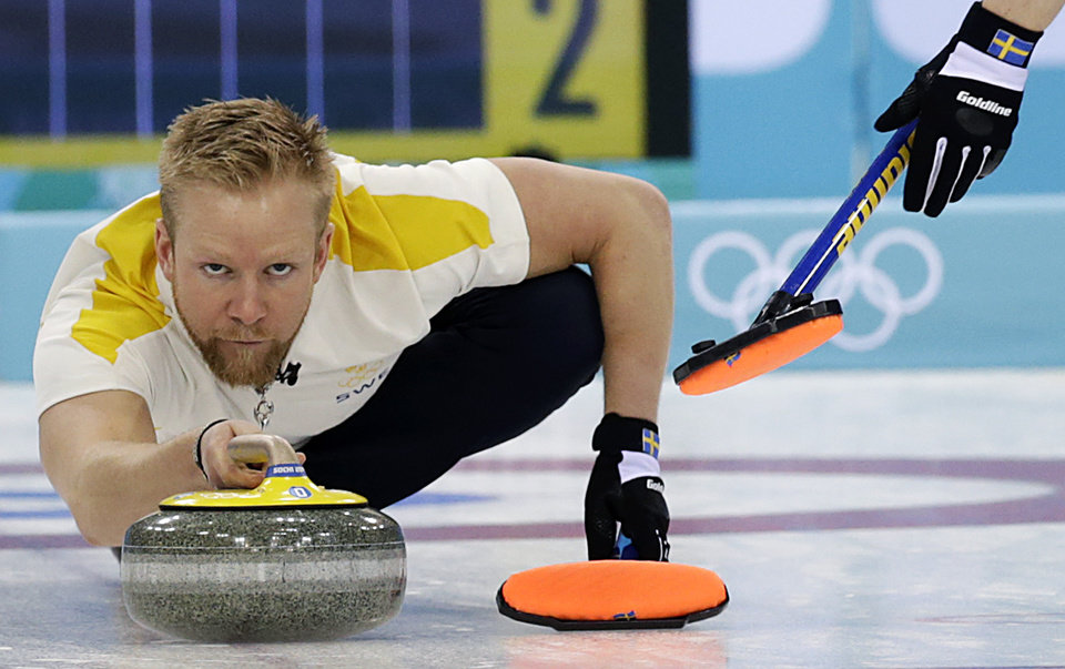Photo - Sweden's skip Niklas Edin, delivers the rock during the men's curling bronze medal game against China at the 2014 Winter Olympics, Friday, Feb. 21, 2014, in Sochi, Russia. (AP Photo/Wong Maye-E)