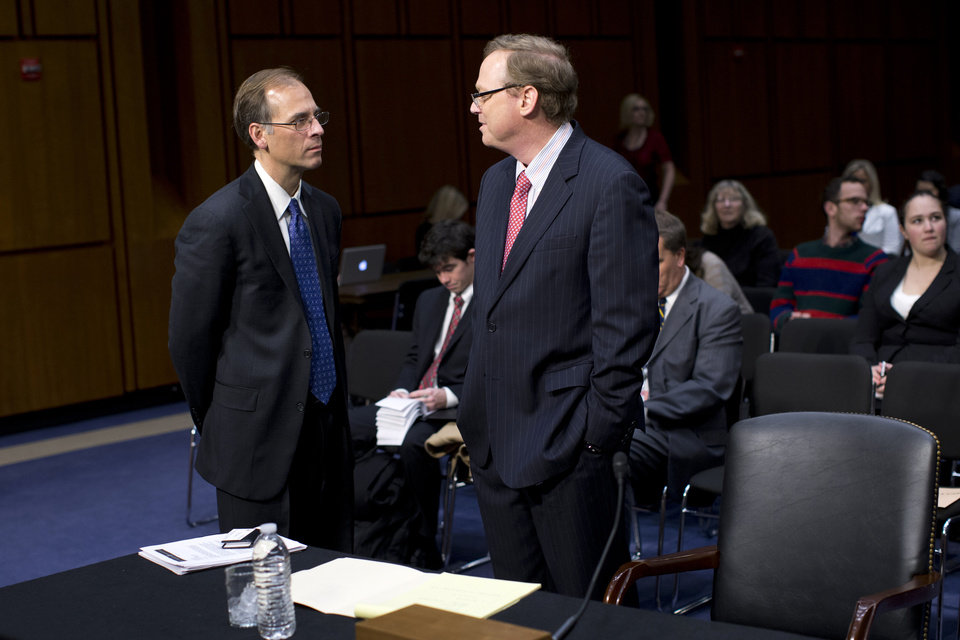 "Mark Zandi, chief economist at Moodys Analytics, left, speaks with Kevin Hassett, senior fellow and director of Economic Policy at the American Enterprise Institute (AEI), on Capitol Hill in Washington, Thursday, Dec. 6, 2012, prior to testifying before the Joint Economic Committee hearing entitled: ""Fiscal Cliff: How to Protect the Middle Class, Sustain Long-Term Economic Growth, and Reduce the Federal Deficit"".  (AP Photo/ Evan Vucci)"