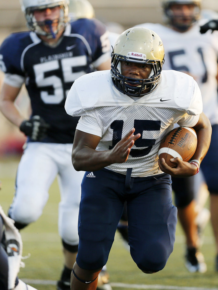 Southmoore�s Karltrell Henderson carries the ball during an Aug. 17 scrimmage at Moore Stadium.  Photo by Nate Billings, The Oklahoman Archives