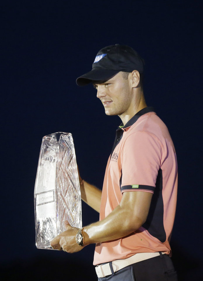 Photo - Martin Kaymer of Germany, holds The Players championship trophy at TPC Sawgrass, Sunday, May 11, 2014 in Ponte Vedra Beach, Fla. (AP Photo/Gerald Herbert)