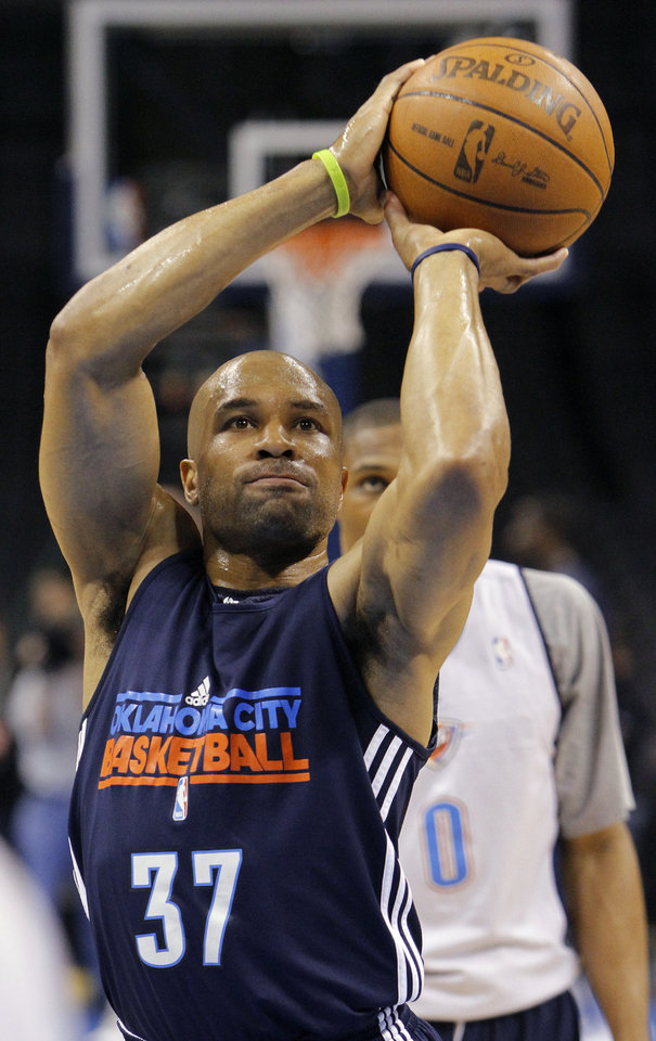 Photo - Oklahoma City's Derek Fisher lines up for a shot during the NBA Finals practice day at the Chesapeake Energy Arena on Monday, June 11, 2012, in Oklahoma City, Okla. Photo by Chris Landsberger, The Oklahoman