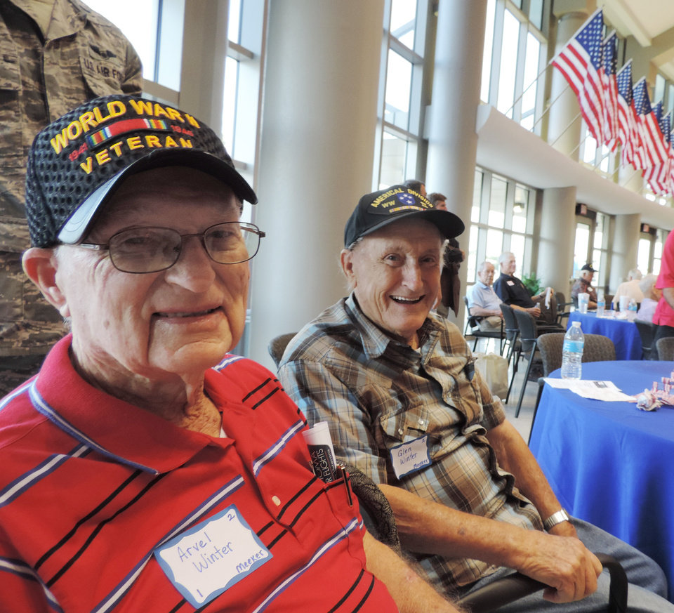 Photo -  World War II Army veterans and brothers Arvel Winter, left, and Glen Winter, both of Meeker, are shown Tuesday at the Oklahoma Honor Flights send-off.    Bryan Painter