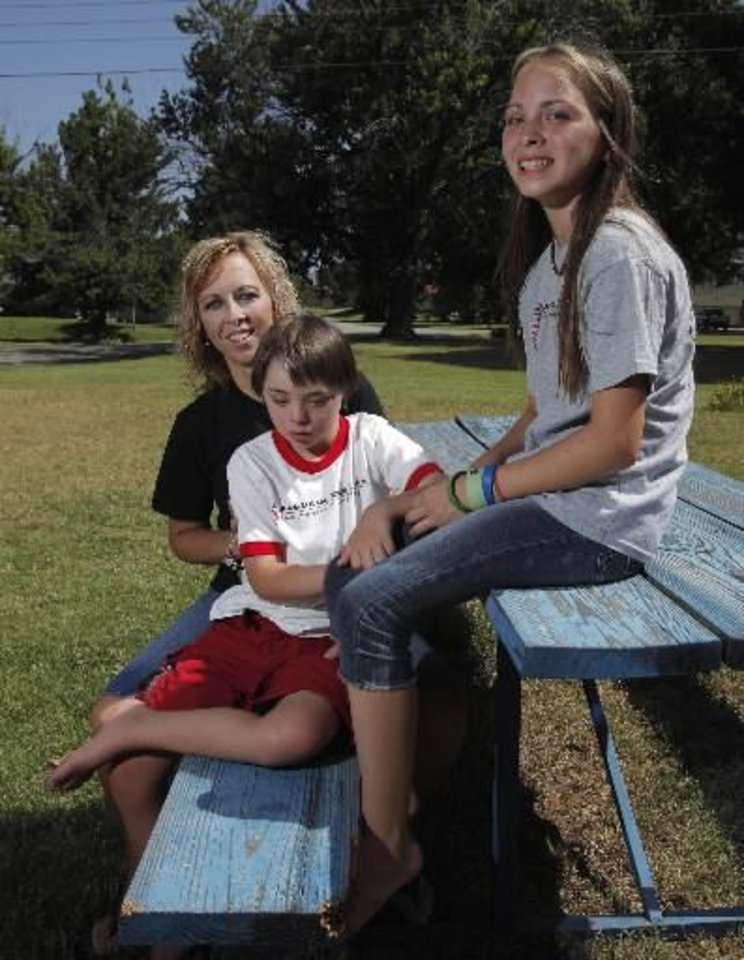 Photo - Holli Griggs-Harjo poses for a photo with her children, Taylor and Hayden, both 11, in Seminole, Okla., July 4, 2012. Photo by Garett Fisbeck, The Oklahoman