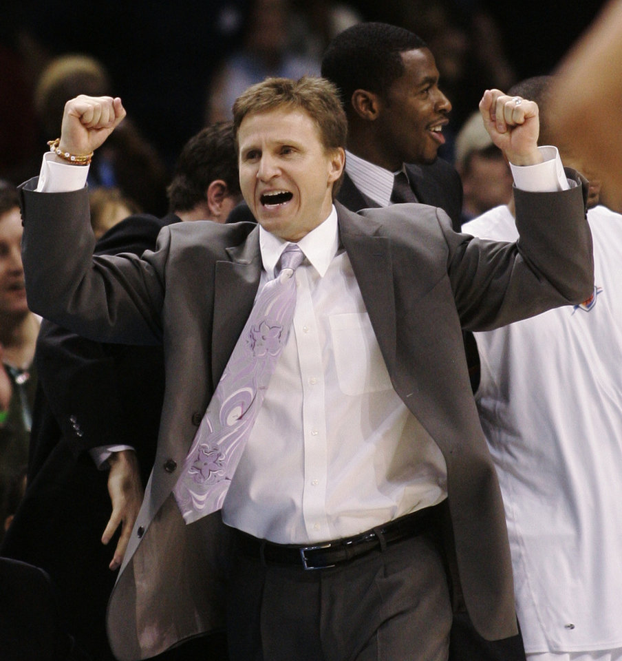 Photo - REACT / REACTION / CELEBRATE / CELEBRATION: Oklahoma City Thunder head coach Scott Brooks reacts as the Thunder score in the second quarter against the Phoenix Suns in an NBA basketball game in Oklahoma City, Tuesday, Nov. 25, 2008. (AP Photo/Sue Ogrocki) ORG XMIT: OKSO101