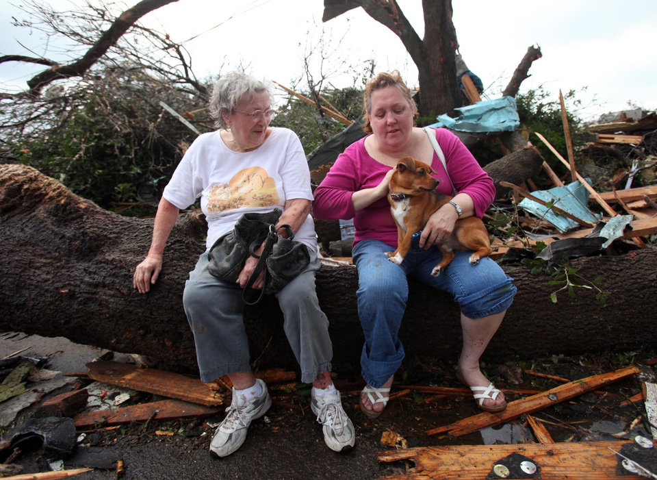 Photo - Lorna McCarter, left, and daughter Susan Hutchins regroup with their dog Shadow after their home was destroyed in the Cedar Crest neighborhood in Tuscaloosa, Ala. Wednesday, April 27, 2011. A wave of severe storms laced with tornadoes strafed the South on Wednesday, killing at least 16 people around the region and splintering buildings across swaths of an Alabama university town. (AP Photo/The Tuscaloosa News, Dusty Compton)