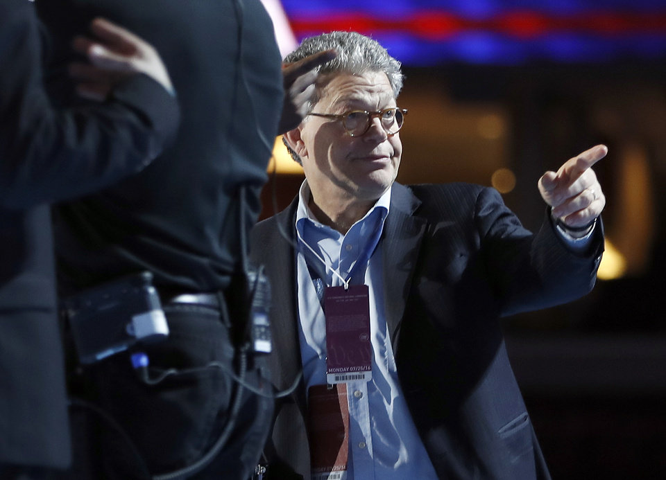 Photo - Sen. Al Franken, D-Minn., checks out the podium before the first day session of the Democratic National Convention in Philadelphia, Monday, July 25, 2016. (AP Photo/Carolyn Kaster)