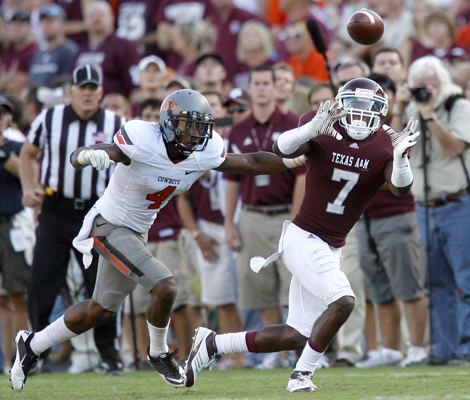 Texas A&M's Uzoma Nwachukwu makes a catch in front of Oklahoma State's Justin Gilbert in the second half of their game Saturday in College Station, Texas. Photo by Sarah Phipps, The Oklahoman