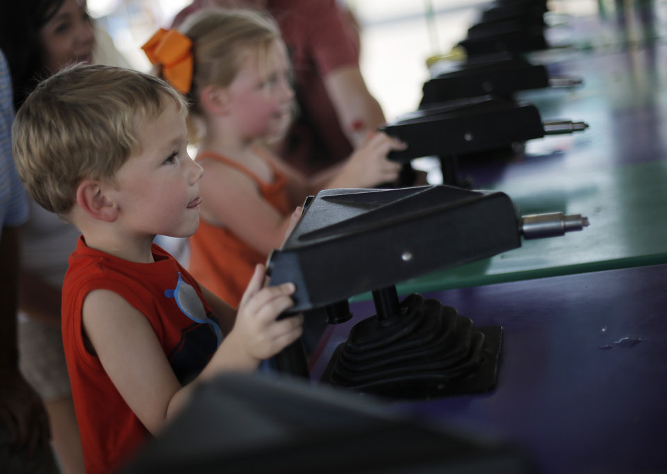 Twins Talan and McKenzie Mars, 3, of Oklahoma City, compete at a booth at the Oklahoma State Fair in Oklahoma City, Friday, Sept. 21, 2012.  Photo by Garett Fisbeck, The Oklahoman