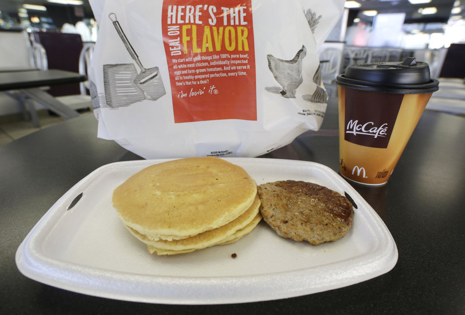 A McDonald\'s breakfast is arranged for an illustration Thursday, Feb. 14, 2013 at a McDonald\'s restaurant in New York. The pancakes and sausage are served on a foam tray and coffee is served in a foam cup. New York Mayor Michael Bloomberg, who has taken on smoking, sugary drinks and salt, talked about banning food packaging made from polystyrene foam from stores and restaurants in his annual State of the City address on Thursday. (AP Photo/Mark Lennihan)