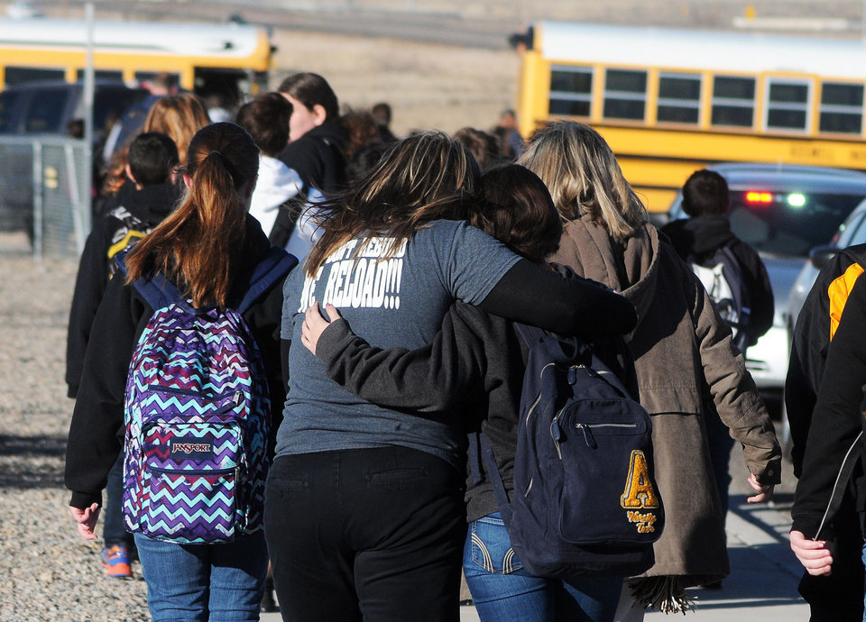 Photo - Students are escorted from Berrendo Middle School after a shooting incident, Tuesday, Jan. 14, 2014, in Roswell, N.M. Roswell police said the suspected shooter was arrested at the school, but authorities have not said if there were any injuries. The school has been placed on lockdown. No other details are yet available. (AP Photo/Roswell Daily Record, Mark Wilson)