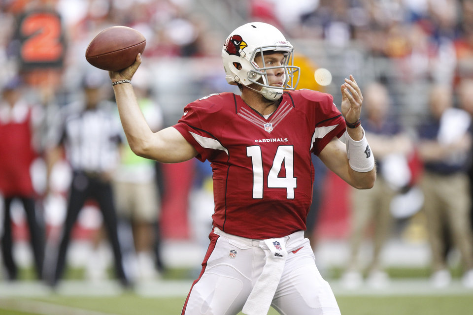 Photo - Arizona Cardinals quarterback Ryan Lindley (14) throws against the Chicago Bears during the first half of an NFL football game, Sunday, Dec. 23, 2012, in Glendale, Ariz. (AP Photo/Paul Connors)