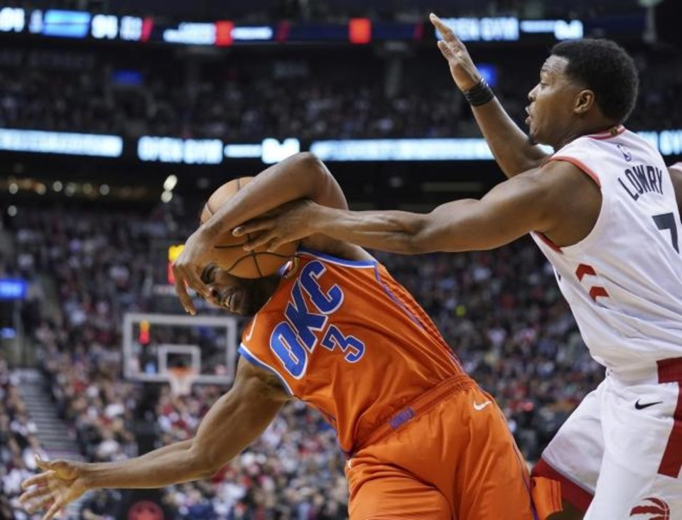Photo - Oklahoma City Thunder Chris Paul (3) battles Toronto Raptors Kyle Lowry for the ball during fourth quarter NBA basketball action in Toronto on Sunday, Dec. 29, 2019. (Hans Deryk/The Canadian Press via AP)