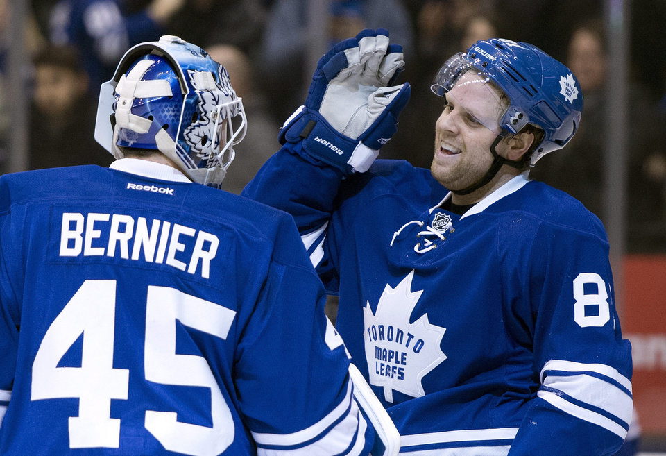 Photo - Toronto Maple Leafs goaltender Jonathan Bernier, left, and Phil Kessel celebrate after an NHL hockey game against the Tampa Bay Lightning in Toronto, Tuesday, Jan. 28, 2014. (AP Photo/The Canadian Press, Frank Gunn)