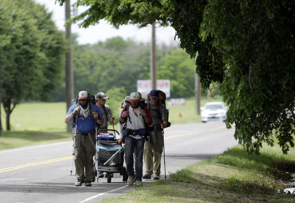 A group walk along Wilshire Boulevard in Oklahoma City, Thursday, April 19, 2012. The groups is walking with a a goat to