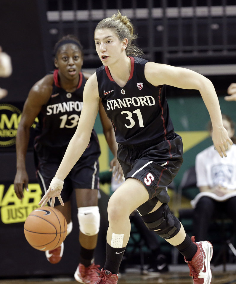 Stanford guard Tony Kokenis, right, heads downcourt on a fast break followed by teammate Chiney Ogwumike during the first half of an NCAA college basketball game against Oregon in Eugene, Ore., Friday, Feb. 1, 2013. (AP Photo/Don Ryan)