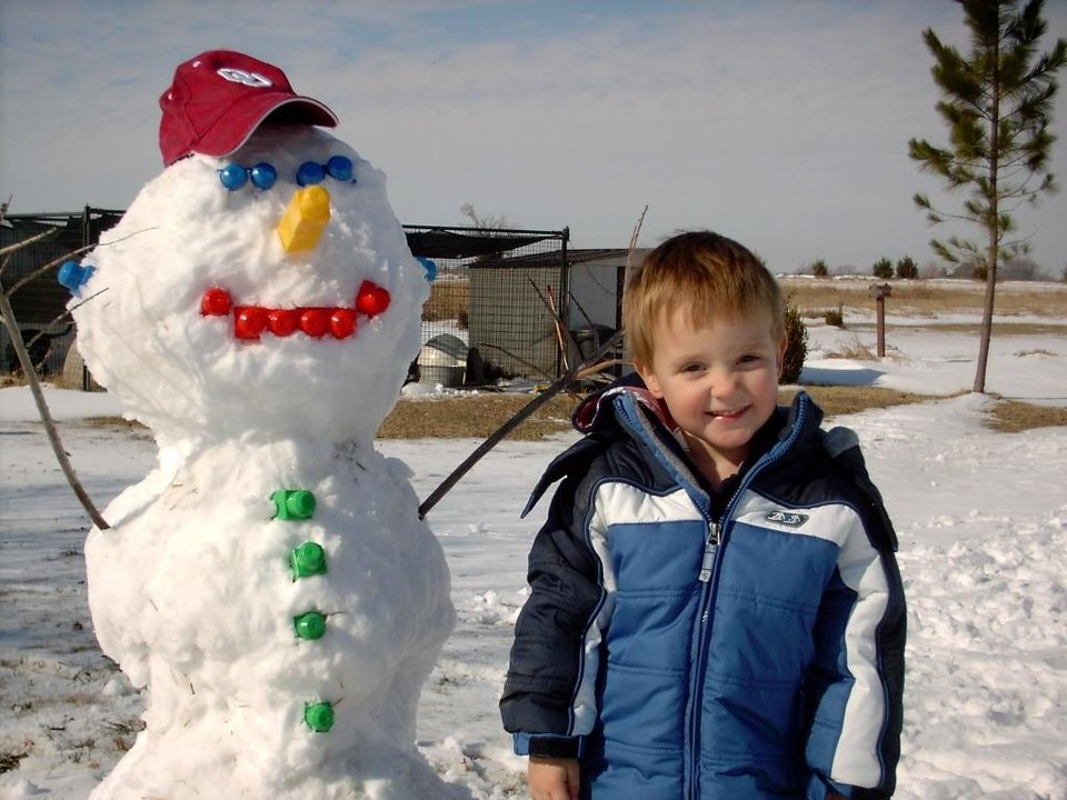 Cooper Downs and his Mega Block Snowman.<br/><b>Community Photo By:</b> Mom, Kathy Downs<br/><b>Submitted By:</b> Katharine, Guthrie