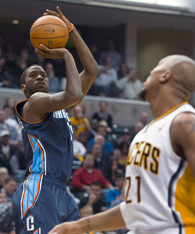 Charlotte Bobcats' Michael Kidd-Gilchrist (14) shoots over Indiana Pacers' David West (21) during the first half of an NBA basketball game in Indianapolis, Saturday, Jan. 12, 2013. (AP Photo/Doug McSchooler)