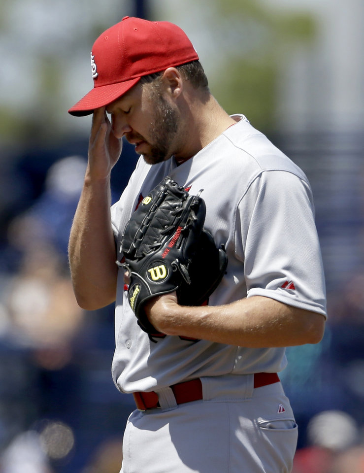 Photo - St. Louis Cardinals starting pitcher Jake Westbrook pauses after after giving up a two-run home run to New York Mets' Collin Cowgill during the fourth inning of an exhibition spring training baseball game Friday, March 29, 2013, in Port St. Lucie, Fla. (AP Photo/Jeff Roberson)