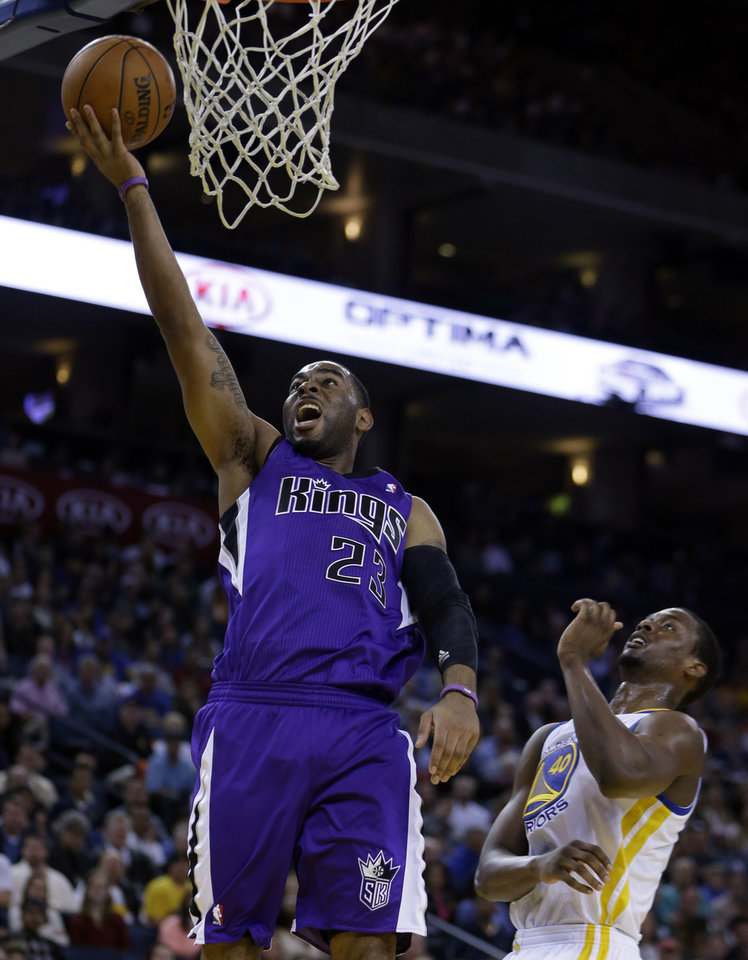 Sacramento Kings' Marcus Thornton (23) shoots past Golden State Warriors' Harrison Barnes (40) during the first half of an NBA basketball game Wednesday, March 27, 2013, in Oakland, Calif. (AP Photo/Ben Margot)