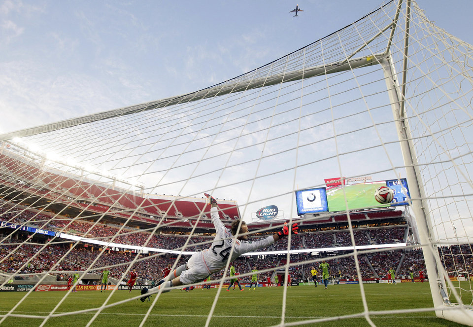 Photo - Seattle Sounders goalkeeper Stefan Frei dives for a shot which went wide during the first half of an MLS soccer match against the San Jose Earthquakes on Saturday, Aug. 2, 2014, in Santa Clara, Calif. (AP Photo/Marcio Jose Sanchez)