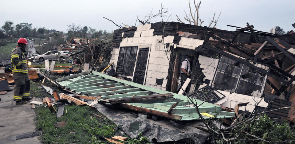 Photo - Rescue personel look for casualties after after a tornado touched down in Birmingham, Ala., Wed., April 27, 2011.(AP Photo,The Birmingham News, Bernard Troncale).
