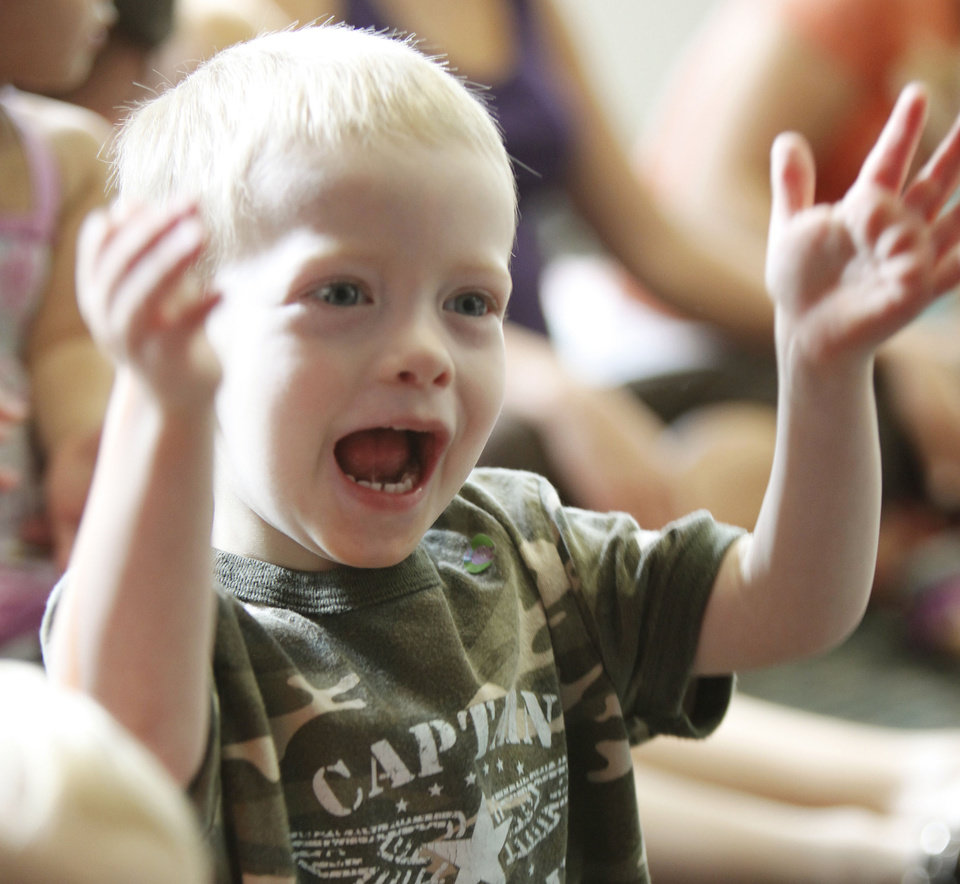 Three-year-old Rhythm Colwell shows his excitement during
