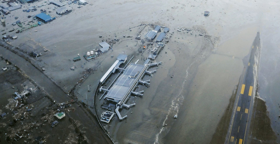 Photo - The tarmac and surrounding area of Sendai Airport is covered with water after a tsunami at in Sendai, Miyagi Prefecture Japan on Friday, March 11, 2011. A ferocious tsunami spawned by one of the largest earthquakes ever recorded slammed Japan's eastern coast Friday, killing hundreds of people as it swept away boats, cars and homes while widespread fires burned out of control. (AP Photo/Kyodo News) JAPAN OUT, MANDATORY CREDIT, FOR COMMERCIAL USE ONLY IN NORTH AMERIC ORG XMIT: TOK831
