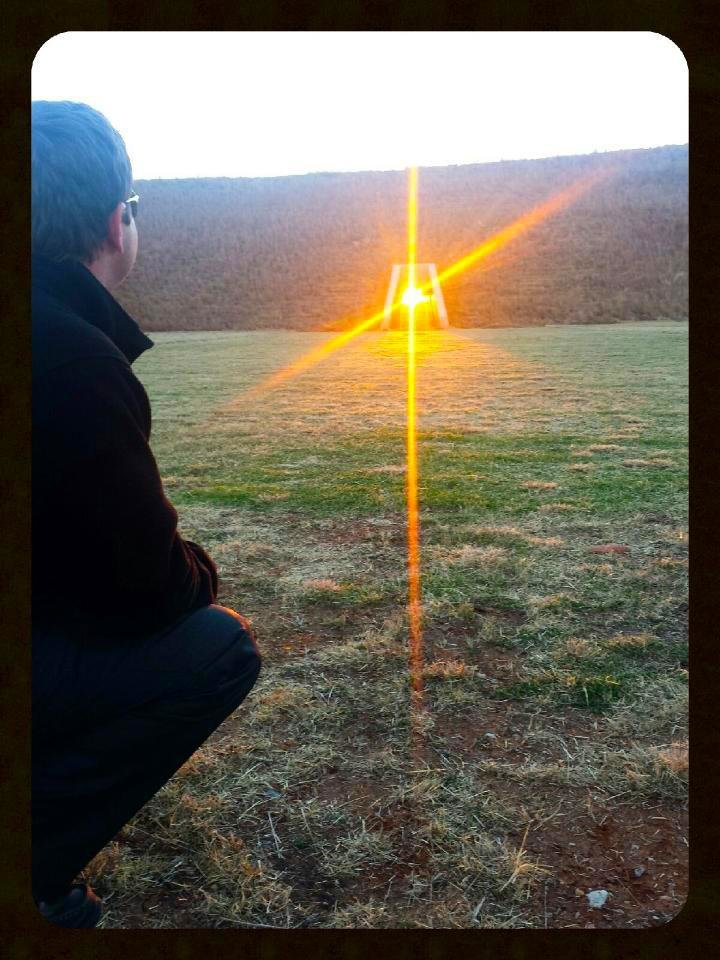 Ryan Barnett, witnessing the alignment of the setting winter solstice sun through the American Indian Cultural Center and Museum\'s West Passage Tunnel. This image of the sun lighting up tunnel captures a magic moment. As the sun sets it appears to float in the tunnel, which cuts through the promontory mound originally designed to align with the setting sun during the winter solstice at the American Indian Cultural Center and Museum. This photo was taken on December 17, 2013 by Leslie Gee.