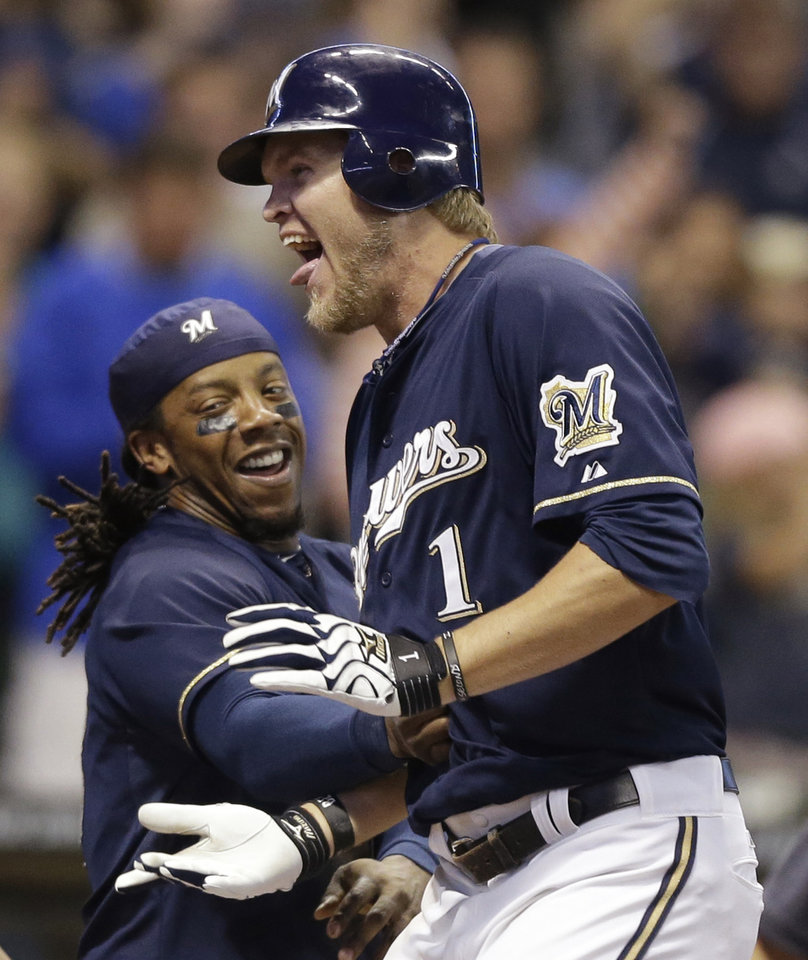Photo -   Milwaukee Brewers' Corey Hart celebrates with Rickie Weeks, left, after his game winning home run against the Pittsburgh Pirates during the ninth inning of a baseball game Saturday, Sept. 1, 2012, in Milwaukee. The Brewers won 3-2(AP Photo/Jeffrey Phelps)