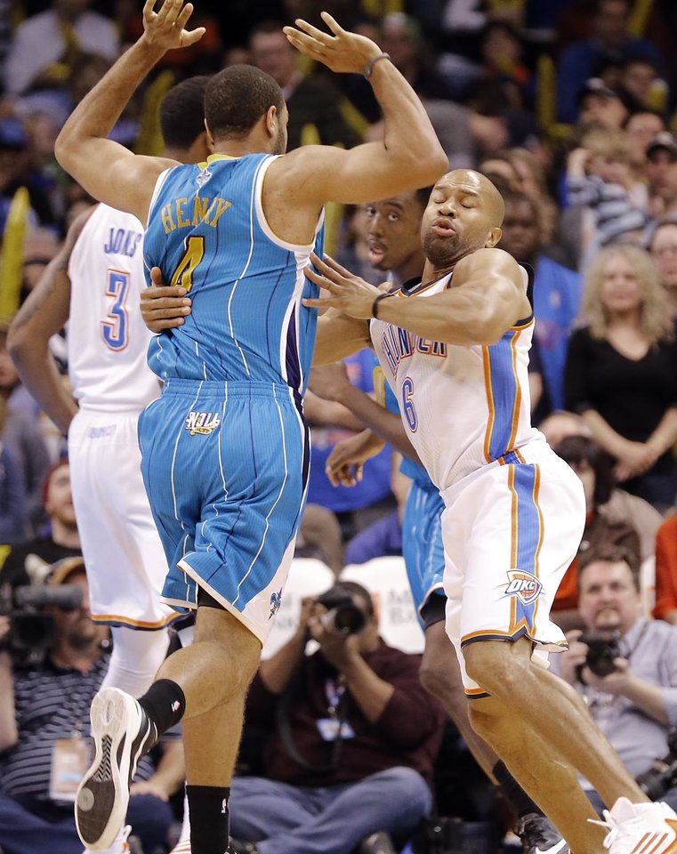Photo - Oklahoma City Thunder's Ronnie Brewer (8) collides with New Orleans Hornets' Xavier Henry (4) during the NBA basketball game between the Oklahoma City Thunder and the New Orleans Hornets at the Chesapeake Energy Arena on Wednesday, Feb. 27, 2013, in Oklahoma City, Okla. Photo by Chris Landsberger, The Oklahoman