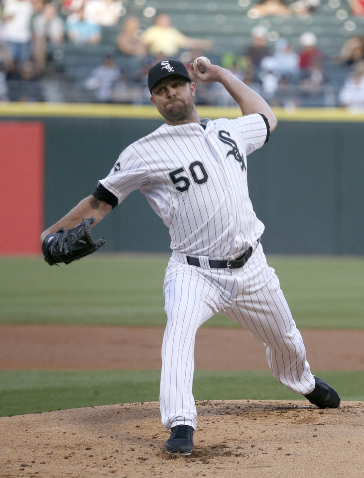 Photo - Chicago White Sox starting pitcher John Danks delivers during the first inning of an interleague baseball game against the San Diego Padres on Friday, May 30, 2014, in Chicago. (AP Photo/Charles Rex Arbogast)