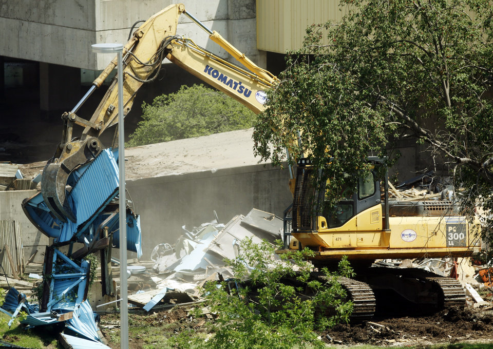 Photo - Heavy equipment is used Tuesday to demolish parts of Stage Center.  KT King -  The Oklahoman