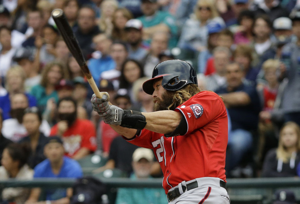 Photo - Washington Nationals' Jayson Werth hits a two-run home run against the Seattle Mariners in the first inning of a baseball game, Saturday, Aug. 30, 2014, in Seattle. (AP Photo/Ted S. Warren)