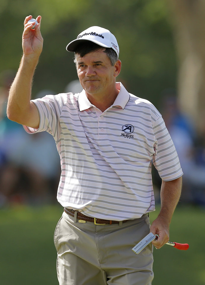Photo - Scott Dunlap waves to the crowd after finishing the third round of the U.S. Senior Open golf tournament at Oak Tree National in Edmond, Okla., Saturday, July 12. Photo by Bryan Terry, The Oklahoman