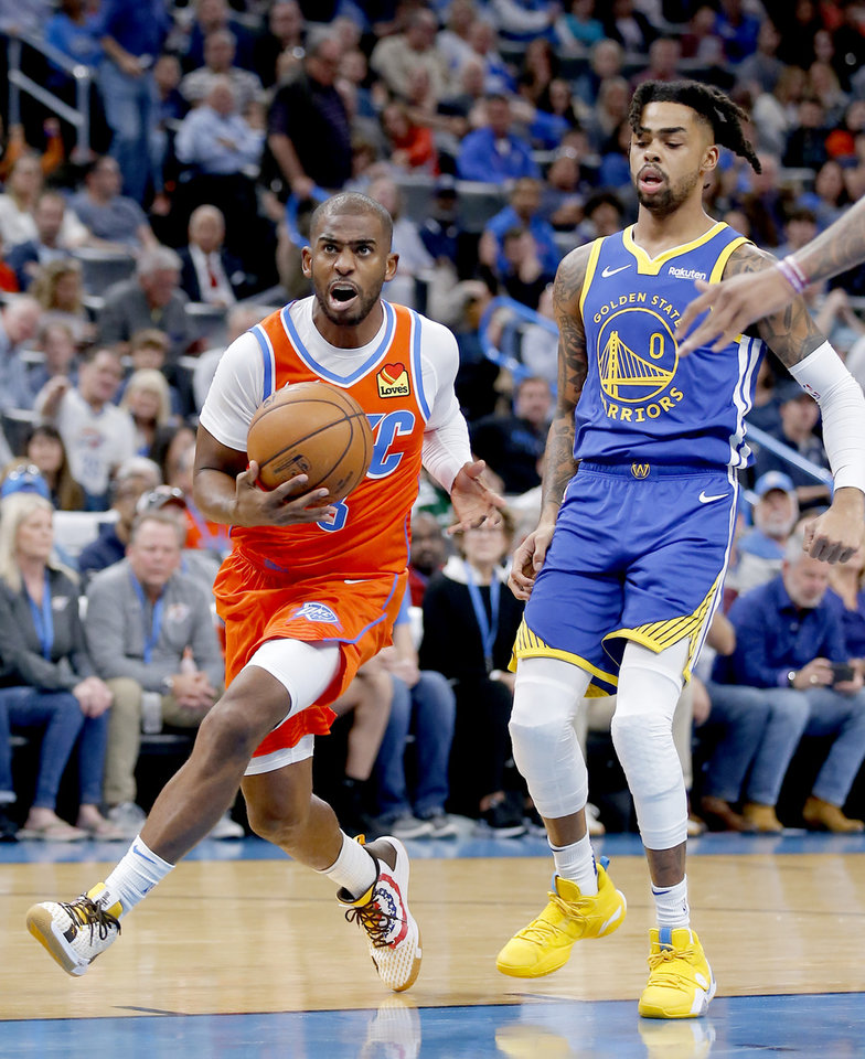 Photo - Oklahoma City's Chris Paul (3) drives to the basket in front of Golden State's D'Angelo Russell (0) during the NBA game between the Oklahoma City Thunder and Golden State Warriors at Chesapeake Energy Arena,  Sunday, Oct. 27, 2019. Thunder won 120-92.[Sarah Phipps/The Oklahoman]
