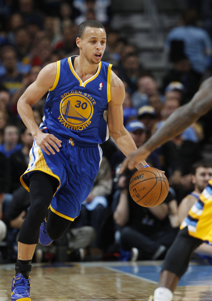 Photo - Golden State Warriors guard Stephen Curry picks up a loose ball against the Denver Nuggets in the first quarter of Game 2 of the teams' NBA first-round playoff series in Denver on Tuesday, April 23, 2013. (AP Photo/David Zalubowski)