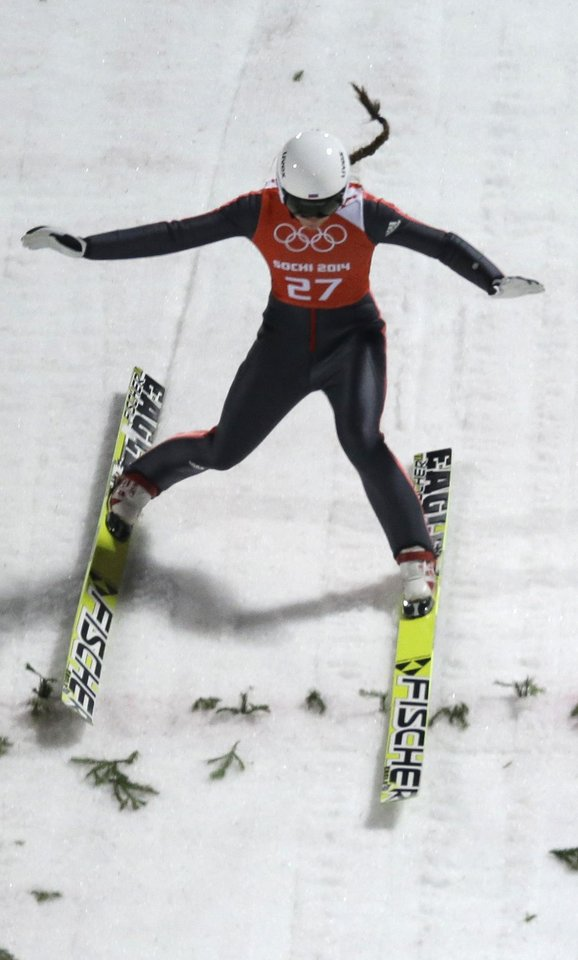 Photo - Russia's Irina Avvakumova makes an attempt during a women's normal hill ski jumping training at the 2014 Winter Olympics, Monday, Feb. 10, 2014, in Krasnaya Polyana, Russia. (AP Photo/Gregorio Borgia)