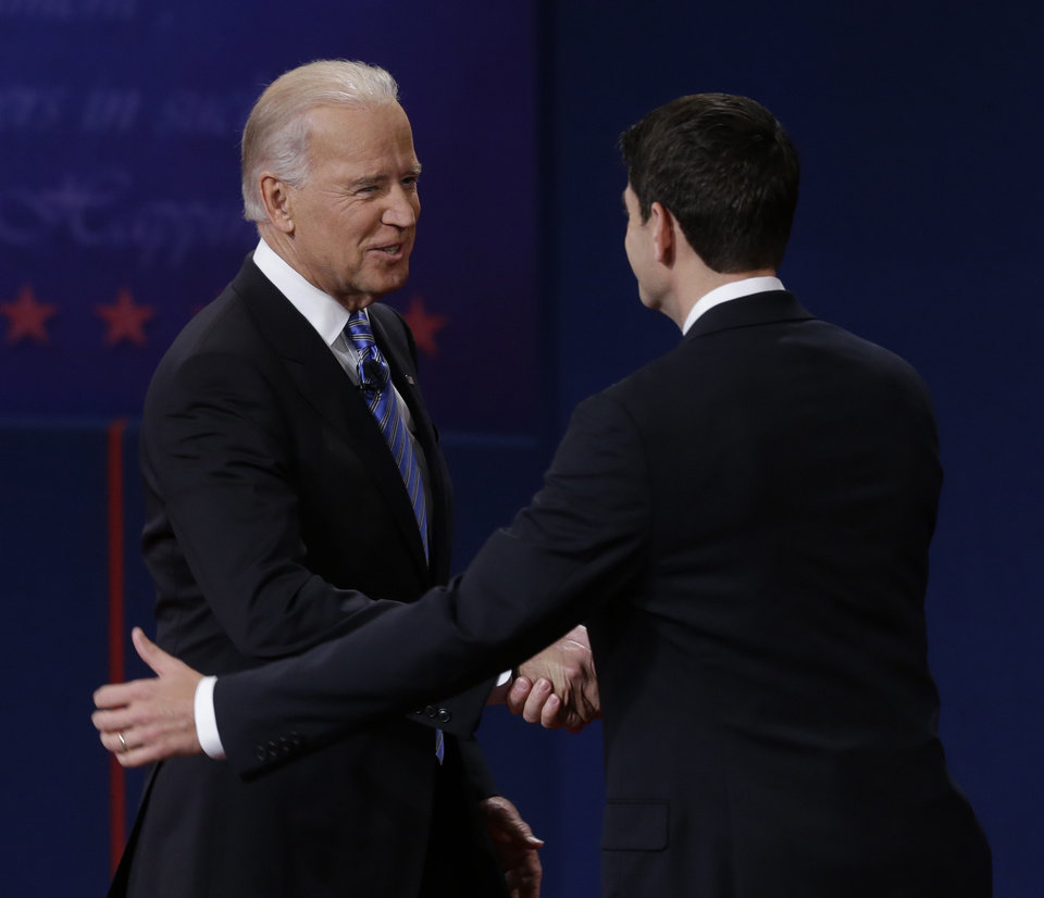 Photo -   Vice President Joe Biden and Republican vice presidential nominee Rep. Paul Ryan of Wisconsin shake hands before their vice presidential debate at Centre College, Thursday, Oct. 11, 2012, in Danville, Ky. (AP Photo/Mark Humphrey)
