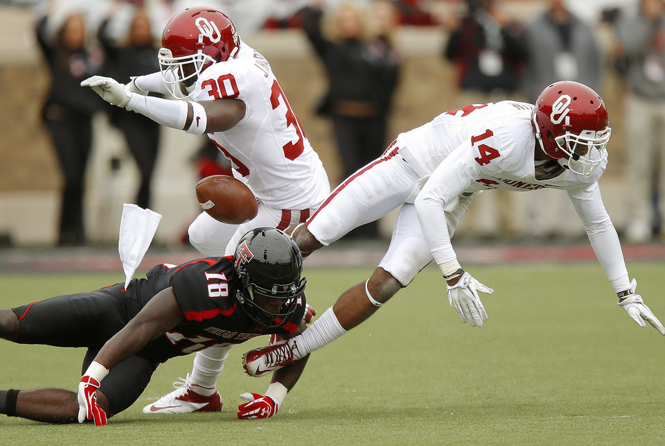 Photo - Oklahoma's Javon Harris (30) and Aaron Colvin (14) break up a pass intended for Texas Tech's Eric Ward (18) during a college football game between the University of Oklahoma (OU) and Texas Tech University at Jones AT&T Stadium in Lubbock, Texas, Saturday, Oct. 6, 2012. Oklahoma won 41-20. Photo by Bryan Terry, The Oklahoman