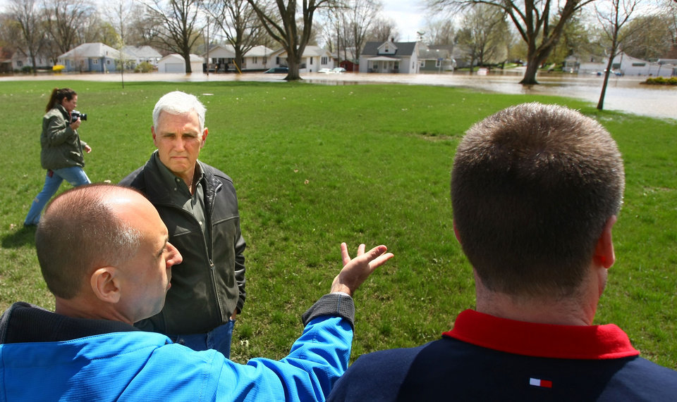Governor Mike Pence gets a tour of the flooded areas of Kokomo, Ind., with Mayor Greg Goodnight as they stop along McCann Street at Haynes International on Saturday April 20, 2013. (AP Photo/Kokomo Tribune, Tim Bath)