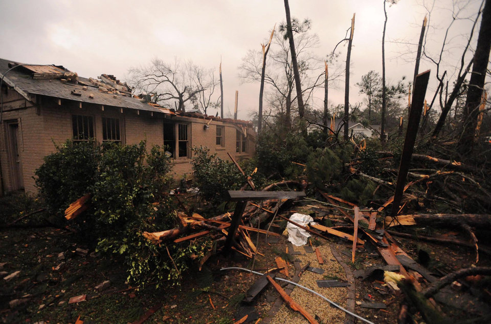 A house is damaged in Hattiesburg Miss. after a tornado passed through the city Sunday, Feb. 10, 2013. (AP Photo/Hattiesburg American, Ryan Moore) ORG XMIT: MSHAT101