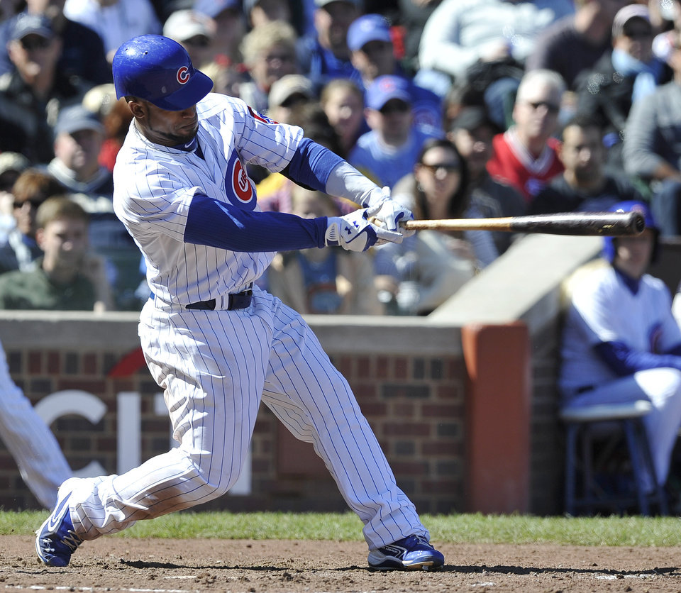 Photo -   Chicago Cubs' Dave Sappelt drives in run with a single against the St. Louis Cardinals during the sixth inning of a baseball game Saturday, Sept. 22, 2012, in Chicago. (AP Photo/Jim Prisching)